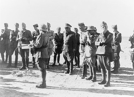 Group of Italian officers, including generals Gastone Gambara and Alessandro Piazzoni, near Tobruk in autumn 1941 Gruppo di ufficiali (tra i generali Gastone Gambara e Alessandro Piazzoni) presso Tobruch nell'autunno 1941.jpg