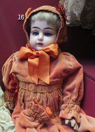 Ernst Heubach - Ernst Heubach bisque headed doll with composition body, in Rochester Guildhall Museum