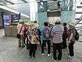 HK Admiralty Tamar Park footbridge lift visitors May-2013.JPG