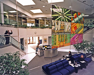 Hans Blohm - Blohm with the two story high installation of the mural in the Mitel lobby.