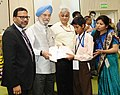 """Hardeep Singh Puri presenting the certificates to the Divyang students from special schools participated in the painting competition, at the World Habitat Day 2017 function, on the theme """"Housing Policies Affordable Homes"""" (1).jpg"""