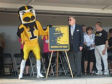 "Hayden Fry during the official dedication of the ""Hayden Fry Way"" in Coralville, Iowa at the 2009 ""Fry Fest."""