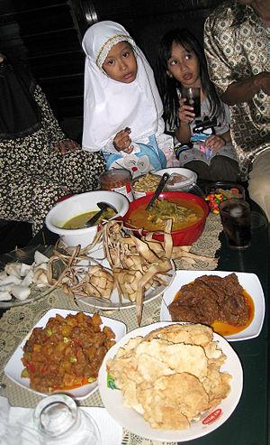 Ketupat - Ketupat as centerpiece of Lebaran feast, served with sayur lodeh, opor ayam, rendang, sambal goreng ati and emping