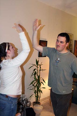 Nonverbal communication - A high five is an example of communicative touch.