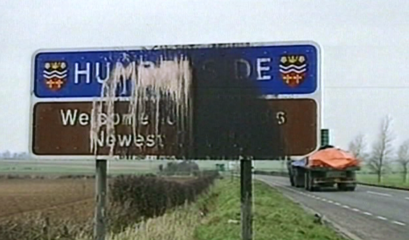 A sign welcoming drivers to Humberside, defaced by black and white splatters.