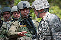 Indian Army Capt. Rohit Sapre discusses tactics for searching weapons caches with U.S. Army Sgt. Micheal Mark.jpg