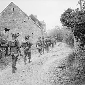 146th Infantry Brigade (United Kingdom) - Infantrymen of the Hallamshire Battalion, York and Lancaster Regiment in the village of Fontenay-le-Pesnel, Normandy, France, 25 June 1944.