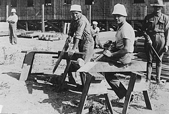 Internment of German Americans - Germans building barracks in an internment camp during World War I