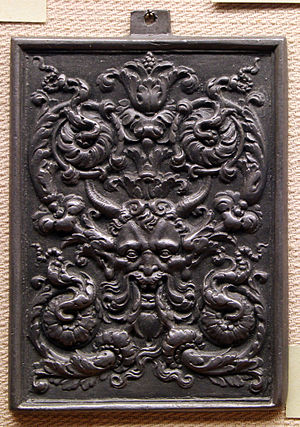 Grotesque - Decorative panel showing the two separable elements of Grotesque: the elaborate acanthus leaf and candelabra type design and the hideous mask or face
