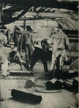 Izumo-class cruiser - Crewmen working the six-inch guns