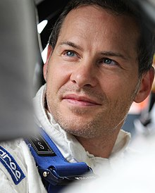 Jacques Villeneuve  - 2018 Dark brown hair & alternative hair style.