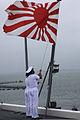 Japan Maritime Self-Defense Force sailors raise the Japanese flag on the helicopter destroyer JDS Hyuga (DDG 181) during Dawn Blitz 2013 at Naval Base San Diego, Calif., June 14, 2013 130614-M-BZ222-002.jpg