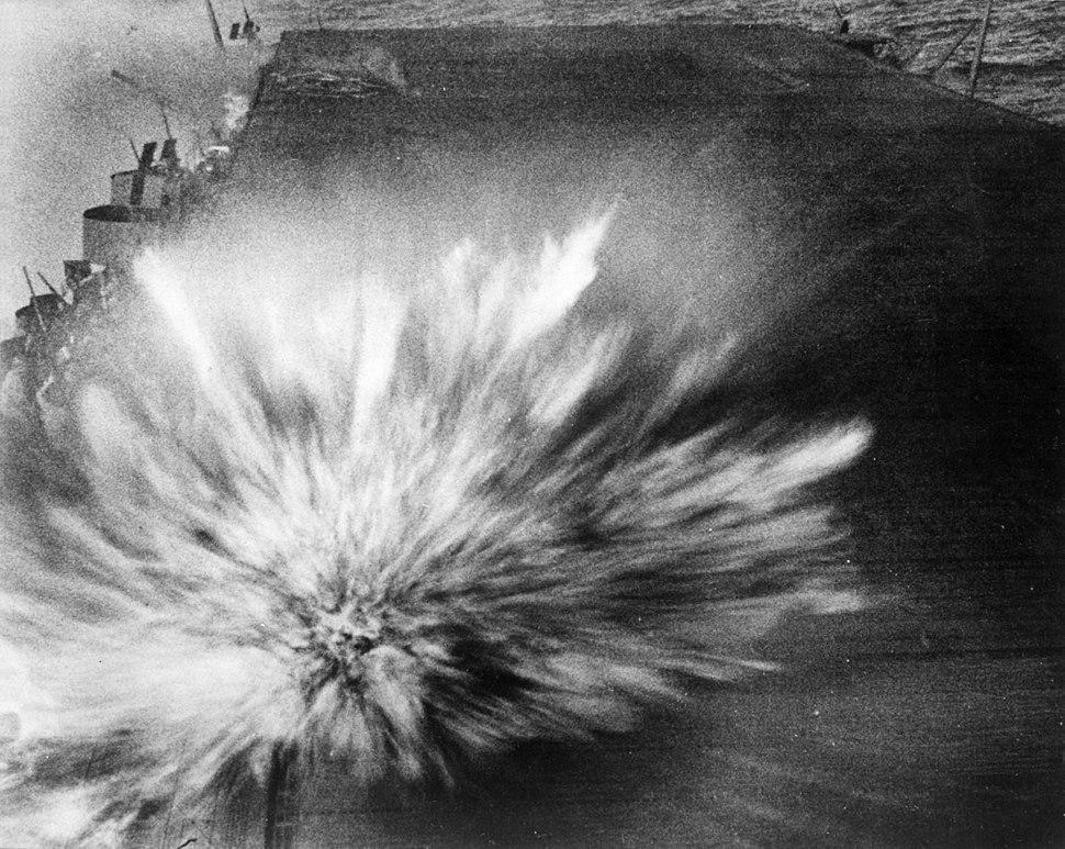 Japanese bomb hits USS Enterprise (CV-6) flight deck during Battle of the Eastern Solomons, 24 August 1942 (80-G-17489)