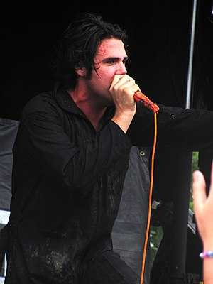 Jason Evigan - Jason Evigan performing with his rock band After Midnight Project at the 2010 Warped Tour.