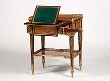 Jean-Henri Riesener's small writing table made for Marie-Antoinette – between 1780–1785, shows some of the queen's favourite flowers represented in the marquetry – including irises, lilacs, lilies, poppies, cornflowers and violets – species that she planted in the gardens of the Petit Trianon. The table can now be seen at Waddesdon Manor, a National Trust property in Buckinghamshire.