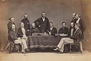 Robert Napier, 1st Baron Napier of Magdala - Robert Napier, sitting third from right, with John Lawrence, Viceroy of India  and other council members and secretaries. c. 1864