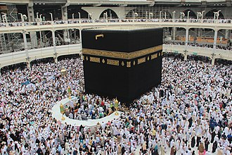Islam in Asia - The Kaaba in Mecca, Saudi Arabia with pilgrims performing the Hajj