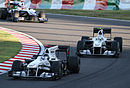 Kamui Kobayashi pursuing Nick Heidfeld 2010 Japan.jpg
