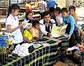 Khamla Panyasouk of Big Brother Mouse reads to children.jpg