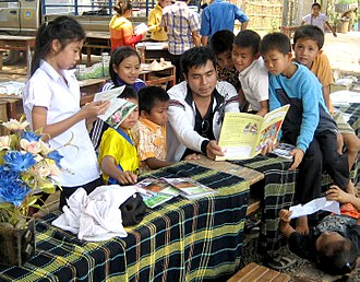 Nonformal learning - Khamla Panyasouk of Big Brother Mouse in Laos reads to children