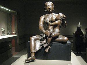Yashoda - Krishna Foster Mother Yashoda with the Infant Krishna. Chola period early 12th century, Tamil Nadu, India.