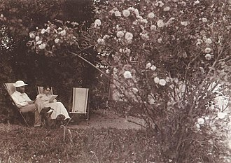 Roses (Krøyer) - A similar scene with Peder, Marie and Rap in the garden taken at around the same time