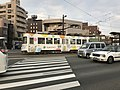 Kumamoto City Tramcar arriving at Giombashi Station.jpg