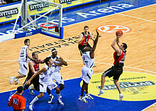 Professional basketball game, with a player preparing to shoot