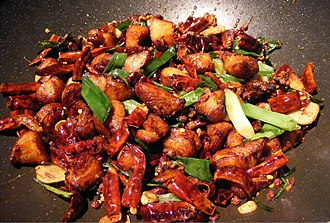 Chinese cuisine - Làzǐ Jī, stir-fried chicken with chili and Sichuan pepper in Sichuan style.