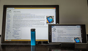 Tablet computer - Crossover tablet device types from 2014: Microsoft Surface Pro 3 laplet, and Sony Xperia Z Ultra phablet, shown next to a generic blue-colored lighter to indicate their size.