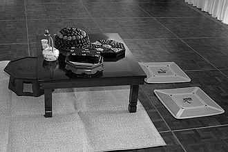 Korean tea ceremony - A typical setting for a Korean tea ceremony disregarding a contemporary tiled rather than paper covered floor.