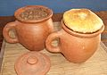 Lobio in clay pots covered with mchadi.jpg