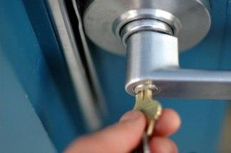 Door handle - Door handle with lock which requires a key to open.