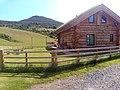Log cabin outside Melrose side.jpg