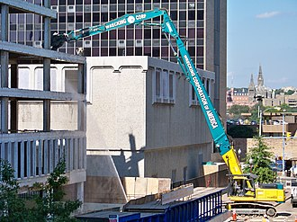 Long reach excavator - A long reach excavator being used to demolish an office building in Rosslyn, Virginia