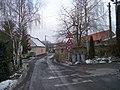 Lounín, silnice, domy čp. 14 a 26.jpg