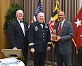 Lt. Governor Addresses the State Defense Force Conference with tiny trophy.jpg
