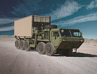 Palletized load system - Oshkosh M1074A1 Palletized Load System (PLS) truck in B-kit configuration and with an Oshkosh Container Handling Unit (CHU)
