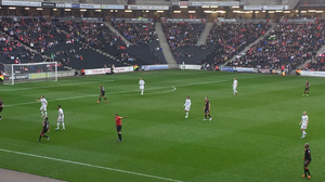 Milton Keynes Dons F.C. league record by opponent - The MK Dons (white kit) in a home match against Sheffield United who they've faced 10 times.