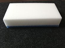 A Magic Eraser, made from melamine foam with blue sponge at the bottom