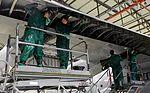 Maintainers clean before painting, inspecting 160104-F-EN010-153.jpg