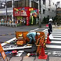 Man hole worker and flag signal man - Tokyo Japan - Nov 2014.jpg