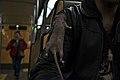 Man with a pet rat in the metro (Herrmann-Debroux station, Auderghem, Belgium, DSCF4082).jpg
