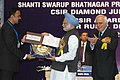 Manmohan Singh giving away the Shanti Swarup Bhatnagar Prize for Science and Technology 2008 to Dr. Srikant Sastri of Bangalore for his outstanding contribution in Physical Sciences, in New Delhi on December 20, 2008.jpg
