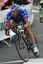 Professional cyclist racing around a bend