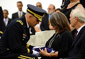Don C. Faith Jr. - Maj. Gen. Michael S. Linnington gives the flag to the daughter of Don C. Faith Jr. during his funeral at Arlington National Cemetery (April 17, 2013)