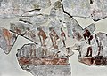 Men in a hunting scene, painted wall fragment from the Pharaoh's mortuary temple at the Pyramid Complex of Sahure, Abusir. Neues Museum.jpg