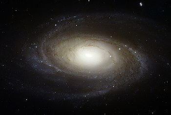 "The spiral galaxy Messier 81 is tilted at an oblique angle on to our line of sight, giving a ""birds-eye view"" of the spiral structure"