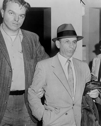Detective - Detective escorting gangster, Meyer Lansky, in 1958, to the 54th Street police station, in New York City