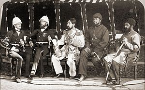 Mohammad Yaqub Khan - Gandamak, Afghanistan in May 1879. Seated from left to right: British officers Mr. Jenkyns and Major Cavagnari, Amir Yakub Khan (in the centre), General Daoud Shah and Habibullah Mustafi.